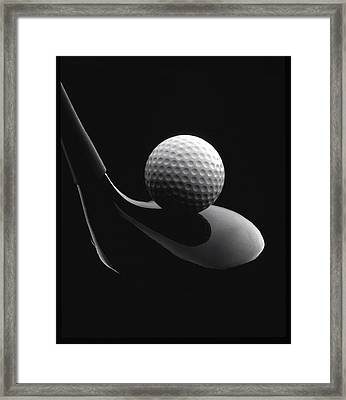 Golf Ball And Club Framed Print by John Wong
