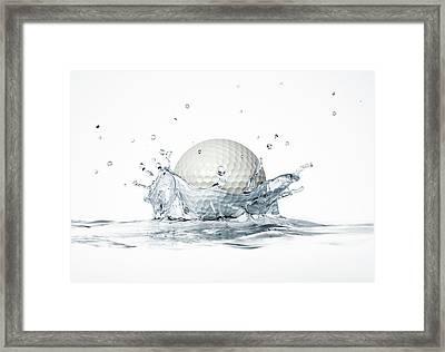 Golf Ball Splashing Into Water Framed Print by Leonello Calvetti