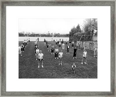 Golf Lessons For Women Framed Print by Underwood Archives