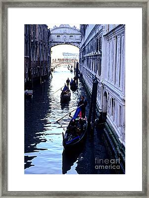 Gondoliers Venice Italy Framed Print by Ryan Fox