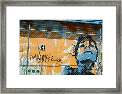 Graffiti Of Woman Behind A Barbed Wire Fence  Framed Print by Michel Sun