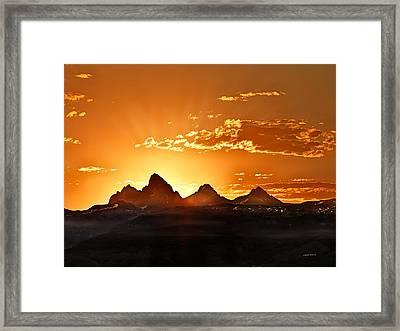 Grand Teton Sunrise Framed Print by Leland D Howard