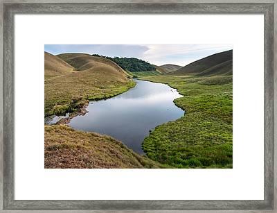 Grassy Hills And Lake Framed Print by K Jayaram
