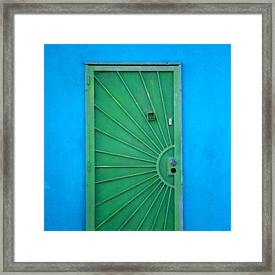 Green Door On Blue Wall Framed Print by Art Block Collections