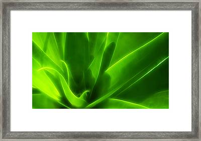 Green Flame Framed Print by Suradej Chuephanich