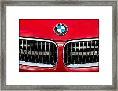 Grill And Logo On A Red Bmw Sports Sedan Framed Print by Wendell Franks
