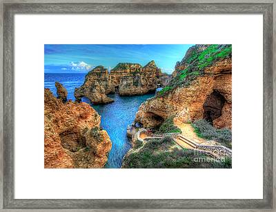 Grottos At Ponta Piedade Framed Print by English Landscapes