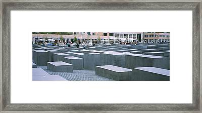 Group Of People Walking Near Memorials Framed Print by Panoramic Images
