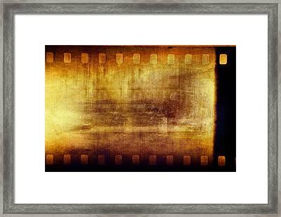 Grunge Filmstrip Framed Print by Les Cunliffe