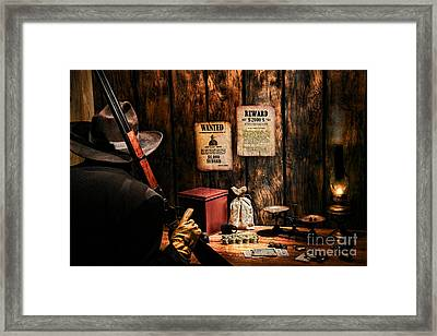 Guarding The Payroll Framed Print by Olivier Le Queinec