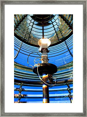 Guiding Light Framed Print by Olivier Le Queinec
