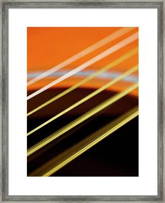 Guitar Strings Vibrating Framed Print by Science Photo Library