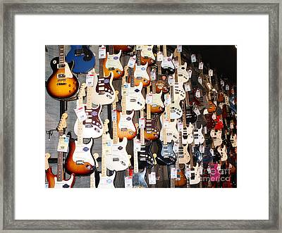 Guitar Wall Of Fame Framed Print by John Telfer