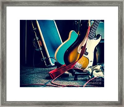 Guitars At Rest Framed Print by Sonja Quintero
