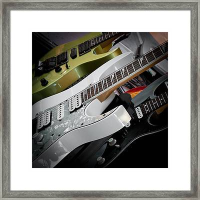Guitars For Play Framed Print by David Patterson