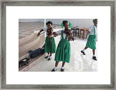 Haitian Girls Play Violins Framed Print by Jim Wright