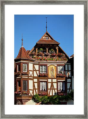 Half-timbered Building In Town Framed Print by Brian Jannsen
