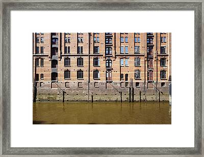 Hamburg - Facade At The Old Warehouse District Of Red Bricks Framed Print by Olaf Schulz