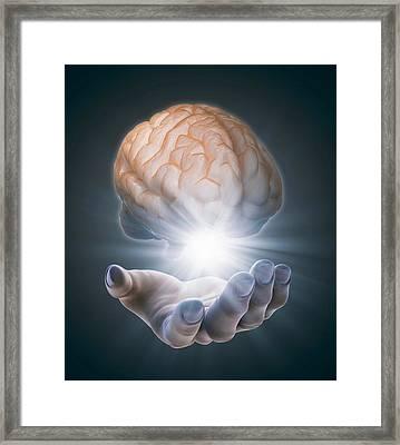 Hand Holding Brain Framed Print by Andrzej Wojcicki