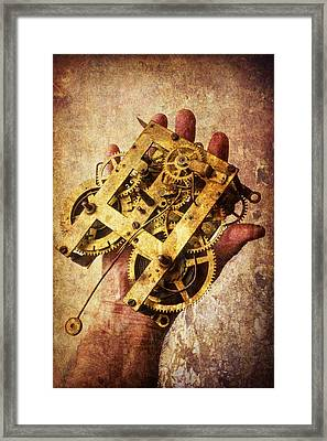 Hand Holding Clock Gears Framed Print by Garry Gay