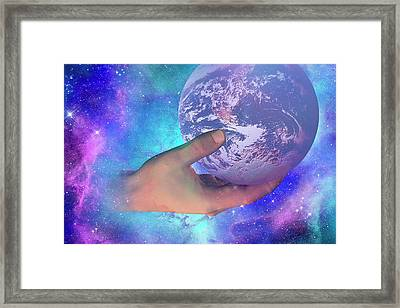 Hand Holding Earth Framed Print by Carol & Mike Werner