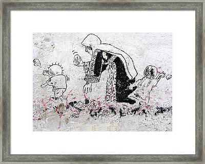 Handala With Family Framed Print by Munir Alawi