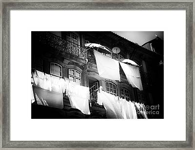 Hanging Laundry Framed Print by John Rizzuto