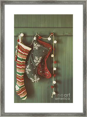 Hanging Stockings Ready For Christmas Framed Print by Sandra Cunningham