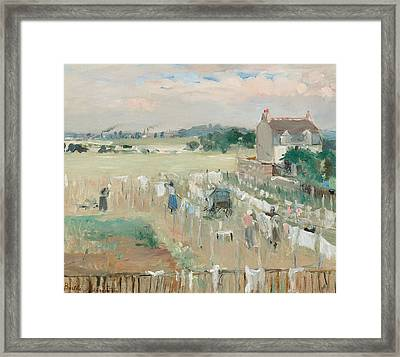 Hanging The Laundry Out To Dry Framed Print by Berthe Morisot