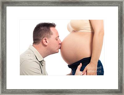 Happy Husband Kissing Pregnant Belly Framed Print by Jan Mika