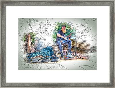 Happy The Busker Framed Print by John Haldane