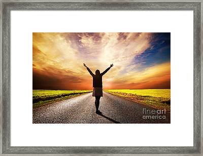 Happy Woman Standing On Long Road At Sunset Framed Print by Michal Bednarek
