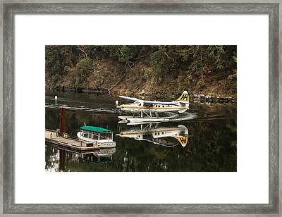 Harbour Air In The Cove Framed Print by John Daly