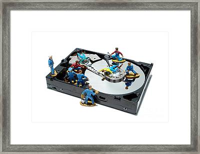 Hard Drive Maintenance Framed Print by Olivier Le Queinec