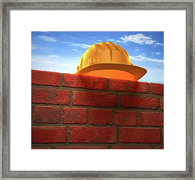 Hard Hat On A Brick Wall Framed Print by Ktsdesign
