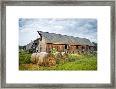 Hay Bales And Old Barns Framed Print by Gary Heller