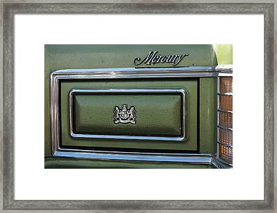 Headlight Cover And The Logo Of The 1975 Green Mercury Marquis Framed Print by Andrei Filippov