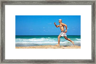 Healthy Man Running On The Beach Framed Print by Anna Omelchenko