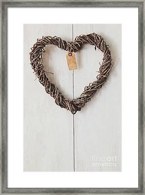 Heart Wreath Hanging On Wood Background Framed Print by Sandra Cunningham