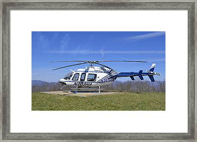 Helicopter On A Mountain Framed Print by Susan Leggett
