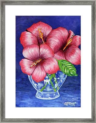 Hibiscus In Glass Vase Framed Print by Caroline Street