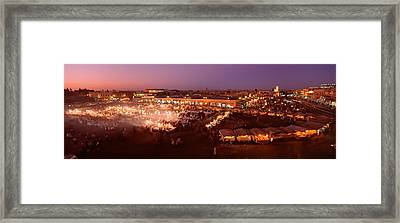 High Angle View Of A Market Lit Framed Print by Panoramic Images