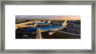 High Angle View Of Airplanes At An Framed Print by Panoramic Images