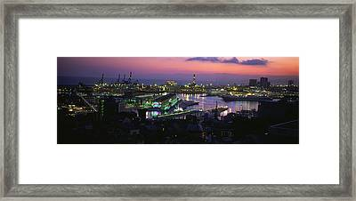 High Angle View Of City At A Port Lit Framed Print by Panoramic Images