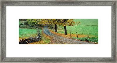 Highway Passing Through A Landscape Framed Print by Panoramic Images