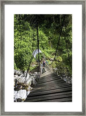 Hikers At Old Kurt Shafer Bridge, Uganda Framed Print by Martin Zwick