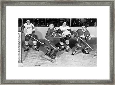 Hockey Goalie Chin Stops Puck Framed Print by Underwood Archives
