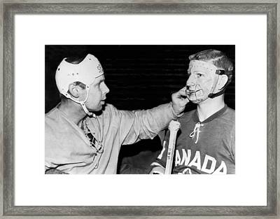 Hockey Goalie Inspects Mask Framed Print by Underwood Archives
