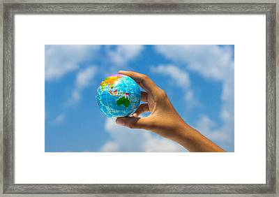 Holding A Globe Framed Print by Aged Pixel