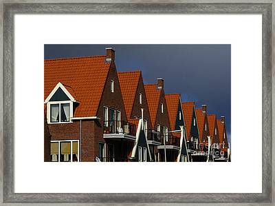 Holland Row Of Roof Tops Framed Print by Bob Christopher